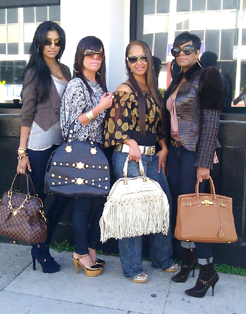 Ladies carrying big purses.
