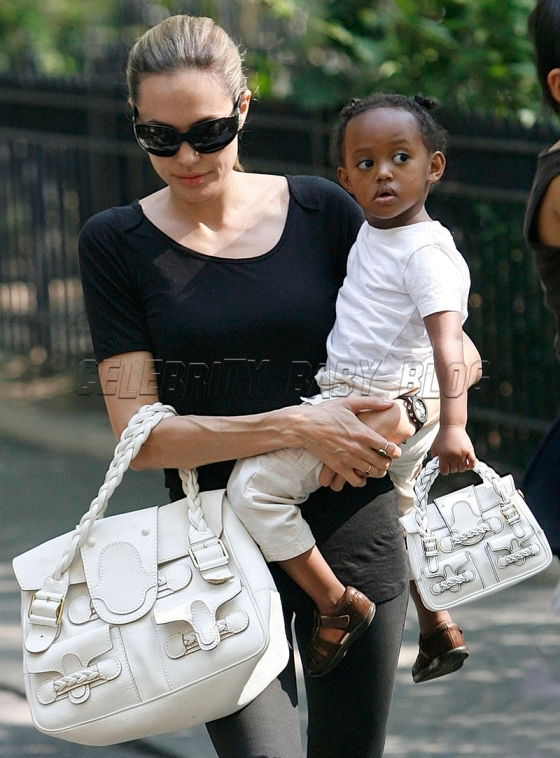 Angelina Jolie and Zahara carry matching purses!
