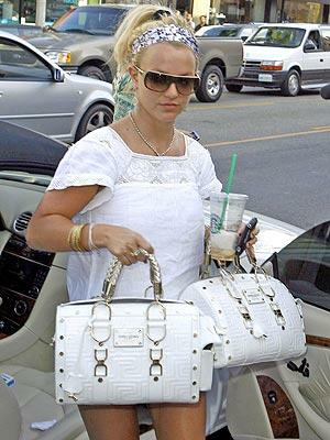 Britney carries two purses?