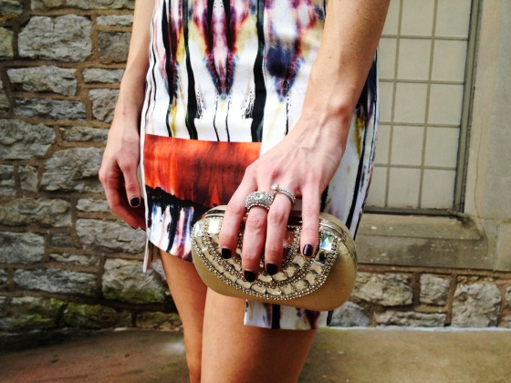 Amy Arnold from The Real Arnolds carrying our Gold One Ring Knuckle Duster Clutch Bag from Chicastic.com